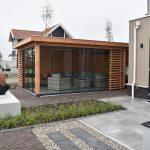 compleet aangelegde tuin met douglas buitenverblijf